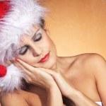 Christmas blonde girl sleeps — Stock Photo