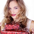 Blonde girl with Christmas gifts — Stock Photo