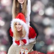 Two happy Christmas girls with gifts — Stock Photo