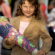Little business girl with a gift — Stock Photo