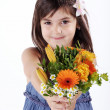 Little girl with a bouquet of flowers — Stock Photo