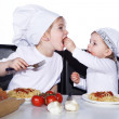 Two little girls eating spaghetti — Stock Photo