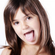 Stock Photo: Little girl shows tongue