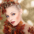 Blonde girl with autumn leaves — Stock Photo
