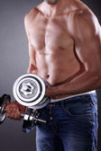 A man with two dumbbells — Stock Photo