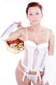 Girl in lingerie with a basket of fruit — Stock Photo