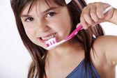 Malá holčička, kartáčky na zuby — Stock fotografie