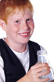 Red-haired boy with Plastic bottle — Stock Photo