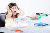 The little girl does his homework sitting at table — Stock Photo