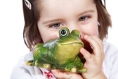 A little girl with a toy toad — Stock Photo