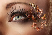 The girl's face in close-up glitter — Stock Photo