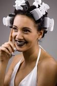 African girl in curlers — Stock Photo