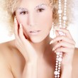 Nude blonde girl with beads — Stock Photo #28491537