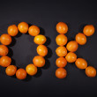 Sign with oranges — Stockfoto