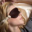 Woman sleeping in bed with eye mask — Stock Photo #28494303