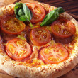 Stock Photo: Tomato pizzon wooden board