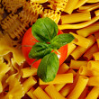 Background of pasta with tomato — Stock Photo