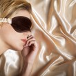 Woman sleeping in bed with eye mask — Stock Photo