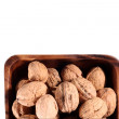Nuts in a wooden plate — Stock Photo