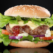 Hamburger on black background — Stock Photo #28496153