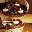 Basket with coffee beans and candles — Stock Photo