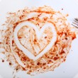 Painted heart on a plate — Stock Photo