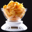 Weigh of potato chips — Stock Photo