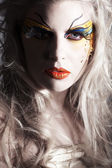 Blonde girl with painted face — Photo