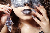 Curly brunette girl in a mask — Stockfoto