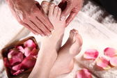 The girl do massage of the foot — Stock Photo