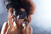 Curly brunette girl in a mask — Photo