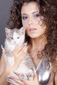 Girl in silver dress closeup with a cat — Stock Photo