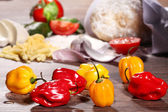 Peppers on a wooden table — Foto de Stock