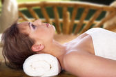 Blonde girl relaxes in the massage salon — Stock Photo