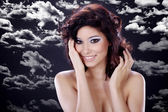 Nude Asian girl on a background of clouds — Stockfoto