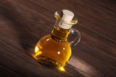 Oil in a glass bottle — Stock Photo