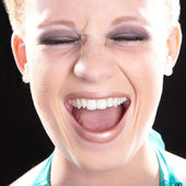 Blonde girl laughs — Stock Photo