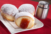 Donuts on a plate with jam — Stockfoto