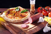 Pizza and food on the table — Foto Stock