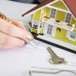 Woman signs documents at home — Stock Photo