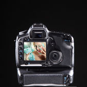 Camera on a black background — Stock Photo