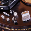 Stock Photo: Calculator and jewelry on table