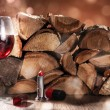 Glass of wine with logs — Stock Photo
