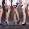 Stock Photo: Feet five girls with handbags in hands