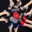 Feet five girls with handbags — Stock fotografie