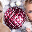 Two girls with Christmas ball — Stock Photo
