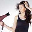 Girl dries hair — Stock Photo