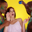 Girl with two African men in the paint — Stock Photo