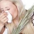 Blond girl sneezes — Stock Photo