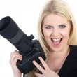 Blonde girl with camera — Stock Photo